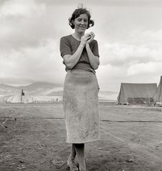 "October 1939. ""Young migrant mother has just finished washing. Merrill Farm Security Administration camp, Klamath County, Oregon."" Medium format nitrate negative by Dorothea Lange for the FSA."