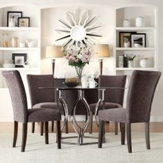 Enhance your modern dining room decor with the Inspire Q Kona 5-piece dining set. The gorgeous hexagon design base in black and nickel finish contrasts beautifully with the upholstery in a chenille finish.