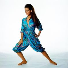 Claudia Cardinale in silk a surah paisley print pajama set by Hollywood Vasarett, 1965. Photo by Bert Stern