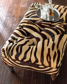 hairhide stenciled with zebra stripes  ---- by massoud.   so you can tuft an ottoman with hair-hide!