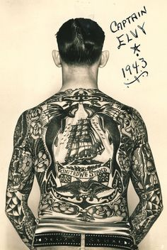 """Captain Elvy, who worked as a sideshow attraction, displays his beautiful back piece designed by """"Sailor"""" George Fosdick."""