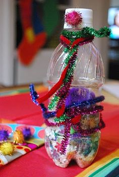 I used empty water bottles and let the kids pick out beads and put stickers all over the bottle. They loved this.. Did it for New Year