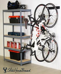 This heavy-duty bike rack is perfect for 2 bikes, holds up to 100 lbs., and is easy to install. Diy Kayak Storage, Bike Wall Storage, Storage Shed Organization, Garage Organisation, Built In Storage, Garage Storage, Organization Station, Bike Hanger Wall, Diy Bike Rack