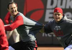 The Reds' Devin Mesoraco, right, pulls on the shirt of teammate Drew Stubbs as they play football during a baseball workout Monday at GABP between Games 2 and 3 of the NLDS.