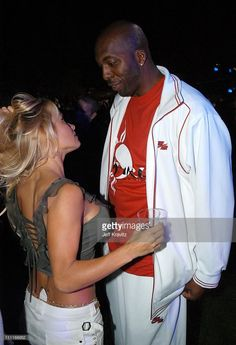 Pamela Anderson and John Salley during The Official Launch Party For Spike TV At The Playboy Mansion - Inside at The Playboy Mansion in Bel Air, California, United States.