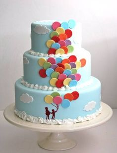 Pretty! Pastel blue cake with bright balloons!