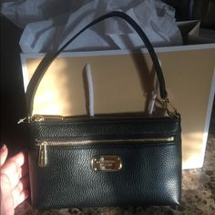 MICHAEL KORS WRISTLET BAG This bags is brand new never use was given to me as a gift but Im not so fond of small bags I'm open to any offer the tag is still on NO TRADES❣ Michael Kors Bags Mini Bags