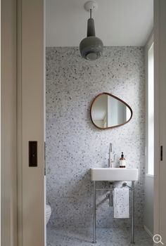 """Powder Room for Children's Playroom / Guest Bedroom.  Bardiglio stone penny tile. Duravit pedestal sink. Vintage staved mirror and glass pendant light fixture.""  Photo credit: Mikiko Kikuyama  https://www.houzz.com/photo/58951199-5th-avenue-residence-contemporary-bathroom-new-york"