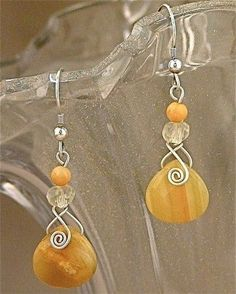 Orange briolette wire wrapped earrings by azibrn