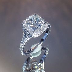 Brand new design model# RS-243 from www.laurenb.com. Highly complex ring that features a sharp cornered #princesscut center diamond in a delicate cushion shaped double-edge halo. This ring also has a tightly split band and fully detailed gallery, all handmade in platinum by our master craftsman. Average jewelers please do not try this at home!
