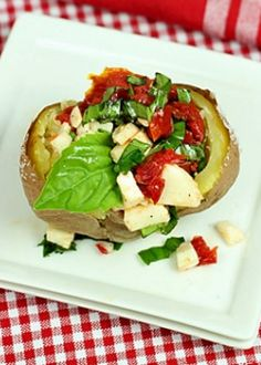 Caprese Stuffed Baked Potatoes - One of those dishes that's almost too good to believe considering the simplicity of preparation. A great reminder of a summer favorite to colder months with the use of roasted or sun-dried tomatoes. Unique Potato Recipes, Baked Potato Recipes, Vegetable Recipes, Vegetarian Recipes, Healthy Recipes, Veggie Dishes, Healthy Dinners, Yummy Recipes, Yummy Food