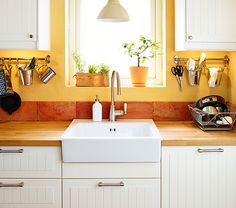 Close-up of sink area, with IKEA basin and taps, with counter space either side.