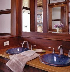 Handmade pottery sinks with vintage-style brushed nickel faucets