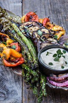 Eggplants peppers zucchini asparagus and onions marinated and grilled till soft on the inside and charred on the outside then doused in garlicky marinade and served with whipped goat cheese on the side. Marinated Grilled Vegetables, Grilled Vegetable Recipes, Grilling Recipes, Vegetarian Recipes, Cooking Recipes, Healthy Recipes, Marinated Asparagus, Whipped Goat Cheese, Vegetable Side Dishes