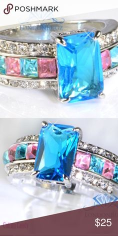 NEW! 3ct Blue CZ Rhodium P Ring w/ baguettes. Sz7 Brand new, Cotton Candy  Rhodium plated 3ct lab created blue CZ. With baguettes and rounds in pink and blue. Very beautiful ring! Size 7.  Bundle and Save.  Happy poshing. LondonBug Jewelry Rings