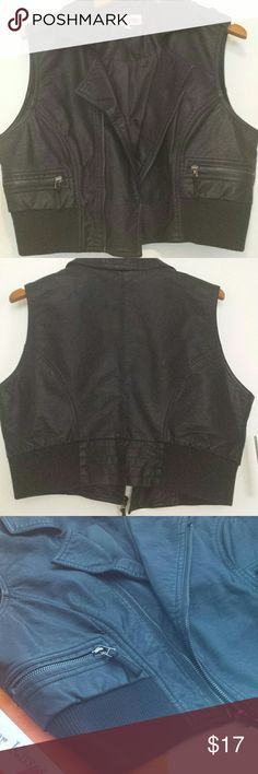 Faux Leather Vest Black sleeveless 'Sugar Kisses' Faux leather vest with 2 front zipper pockets. Zipper opening in front and 2 button epaulettes on shoulder. Black lining is 100% polyester. Junior's size 2X. New, never worn with Tags. Sugar Kisses  Jackets & Coats Vests