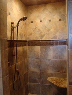Different Shaped Tiles In The Same Color Scheme And Material Bring Dynamic Visual Interest Into This Shower Kk Ideas Pinterest Patterns