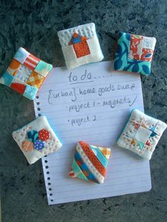 Mini Mini Quilt Magnets - http://feelincrafty.wordpress.com/2012/11/13/to-do-list-swap-quilted-magnets-with-a-tutorial-done/