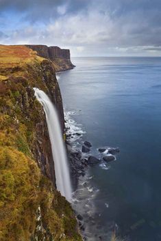 Isle of Skye - the 60-metre-high Mealt Falls on The imposing cliffs in the background are Kilt Rock, a rocky outcrop with vertical basalt columns said to resemble a pleated kilt.