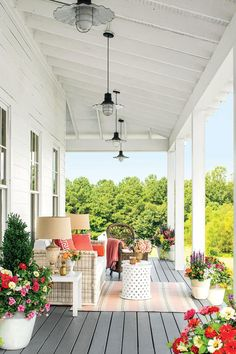 Charming Farmhouse Porch | Patios and porches are an integral part of Southern culture. These classics are inviting and inspiring. It's no secret that we Southerners live for our porches. Is there any memory sweeter than those of childhood suppers on screened porches, or swinging the night away on the perfectly-designed porch. Face it: we pay for our mild winters with our sultry summers, and while modern air-conditioning may have made those deep porches of the past unnecessary, our Southern