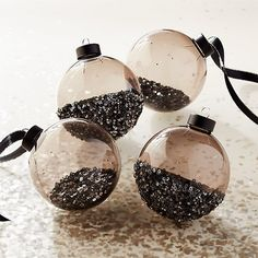 Sequin Ornaments Set of 4 Shop Sequin Ornaments Set of Four smoke glass ornaments sparkle in sequins to dress up your tree. Two partially filled inside and two half-dipped outside. Modern Christmas Ornaments, Black Christmas Trees, Christmas Tree Themes, Christmas Diy, Christmas Bulbs, Xmas, Black Christmas Tree Decorations, Christmas Mantles, Homemade Christmas
