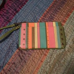 Fossil Wristlet This wristlet has been used maybe once or twice. Excellent condition! No stains, tears, etc. lots of pockets inside and 2 outer pockets. Fossil Bags Clutches & Wristlets