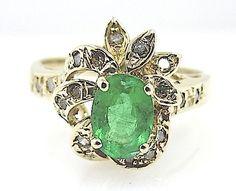 Online veilinghuis Catawiki: Geelgouden ring met diamanten en een smaragd