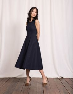 You can actually hear the quality of this soft cotton poplin fabric – the full skirt quietly rustles as you walk. A touch of stretch, a fitted bodice and princess seams create a flattering fit and help the dress keep its elegant shape as you dance the night away.