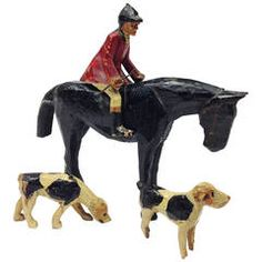 19th Century English Folk Art Group Depicting a Huntsman with Two Hounds