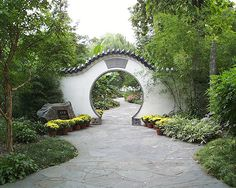 "A traditional Chinese circular entrance, or moon gate, creates the sense of entering a special place. The circle is a symbol of perfection to the Chinese, who have a saying, ""Flowers are beautiful when the moon is full.""   Missouri Botanical Gardens.  #garden #design"