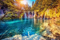 majestic-view-on-turquoise-water-and-sunny-beams-in-the-plitvice-lakes-national-park-croatia-shutterstock_266538056-2