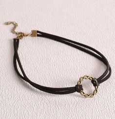 A fashion choker with a knot talisman to attract and keep your love…
