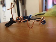 'love' DIY wire bracelet. Tutorial can be found here: http://diynosaurs.tumblr.com/post/23446472641/materials-wire-pliers-rounded-and-flat-wire