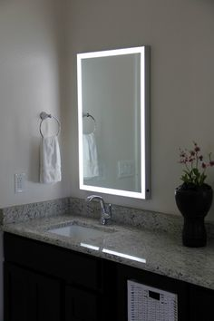 This Stylish LED Illuminated Mirror from Lighted Image is the must have addition to your home or office space. Featuring an Aluminum Frame and LED's around the edge, this stunning contemporary LED bathroom mirror will compliment any space. Backlit Bathroom Mirror, Bathroom Mirror Design, Small Space Bathroom, Bathroom Mirror Cabinet, Mirror Cabinets, Bathroom Colors, Bathroom Sets, Bathroom Lighting, Led Mirror