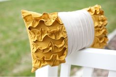 ruffles. pillows. bAaH!!! Love them!!! I could make red or cream ones for our bed. cute.