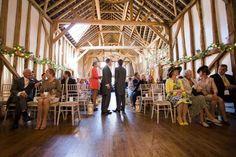 guests and groom waiting for ceremony to start at Pitt Hall barn Basingstoke