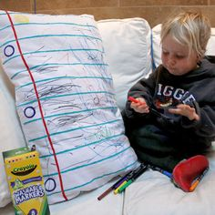 Kids doodle pillowcase - draw a margin and lines using fabric paint on a standard white pillowcase and iron to set paint then wash and ready to use!