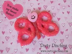 Dip some pretzels in Candiquik and coat in pink sugar sprinkles, attach a sour punch straw in the middle along with a conversation heart with a smiley face (use a black edible marker) and you have a cute snack that will make anyone's heart flutter!