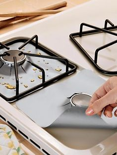 Keep Your Gas Range Spotless—Without Scrubbing! Boiled over beans? Greasy bacon splatters? Burnt-on mess? Not a problem with this set of fou...