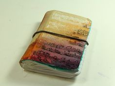 altered mini book..this is a great way to do a cover for any journal or album