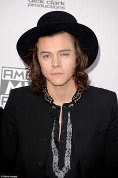 Dapper dude: Styles cut a stylish figure at the annual awards ceremony in Los Angeles ...
