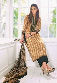 Give a new life to your #ethnic casual wardrobe with this Beige-Black Color Pure Cotton Designer #SalwarKameez which is accomapnied with a printed dupatta and bottom. The suit showcases chic prints and a embroidered patched yoke.