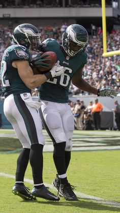 Jaylen Watkins #26 and Chris Maragos #42 of the Philadelphia Eagles down the ball near the goal line after a punt in the fourth quarter against the Cleveland Browns at Lincoln Financial Field on September 11, 2016 in Philadelphia, Pennsylvania. The Eagles defeated the Browns 29-10.
