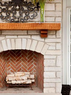 Brick Patterns. This firebox breaks the mold by using bricks to create a chevron pattern as opposed to the basic, stacked design. Varying shapes and sizes of the light-color stones on the hearth and fireplace surround is more organic, contrasting the orderly brick pattern in the firebox.