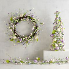 Since ancient times, the egg has been a symbol of new life, and our handcrafted wreath features faux eggs, large and small, in opalescent pastels. To announce your joy that spring is near, decorate with our beaded egg Easter decor collection.