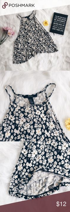 """F21 Daisy Print Halter Neck Tank Top ▪️Product Description▪️ ▫️Summer time daisy style with this adorable tank top   ▫️Thin material and super soft  ▫️Pair with a lace bralette found in my closet  ▫️Halter style top with a high neck  ▫️Sides are slightly longer than the center   ▪️Fit: Medium, but more of a small, will show sides of bra so I do recommend a bralette or bandeau be worn with this, flowy and boxy fit  ▪️Condition: Excellent   ▪️Measurements: Approx/Laying Flat  ▫️Width- 16""""…"""