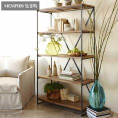 French village LOFT-style rack wrought iron in a old wooden clapboard Bookshelf…
