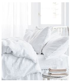 Love the all-white look of this bed.