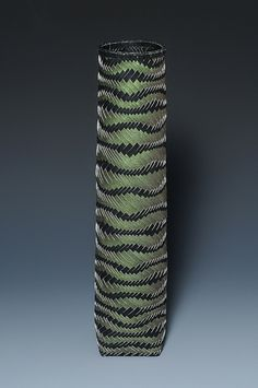 Grass by Dorothy McGuinness. She uses traditional bamboo techniques with the paper s her medium.  http://dorothymcguinnessbasket.com