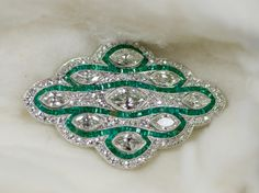 Pendant Brooch  retailed by Cowell and Hubbard Co. (American, b. )    Date: 1925-1930    Medium: platinum, diamonds, and emeralds